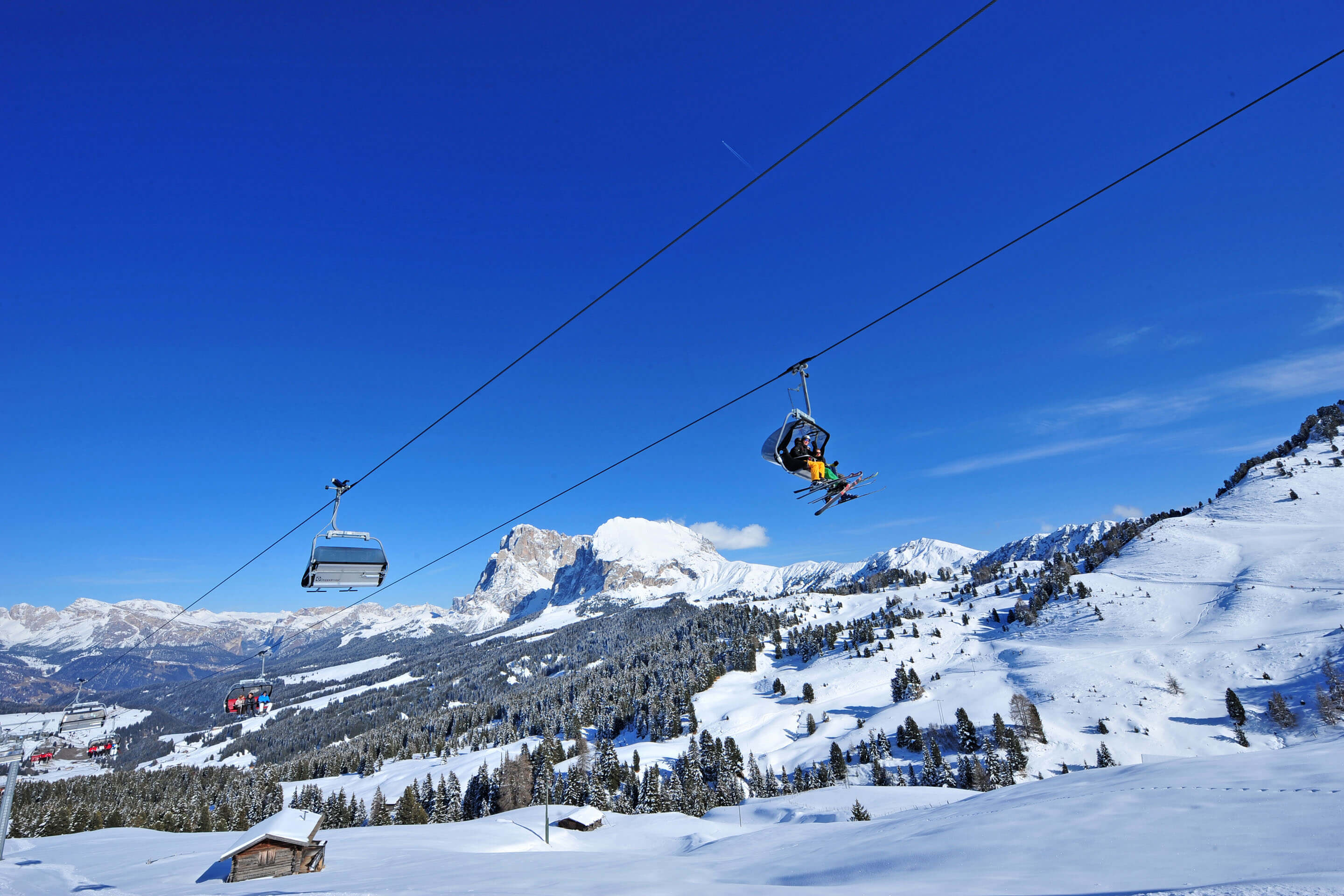 Skiing under the winter sun of the Dolomites